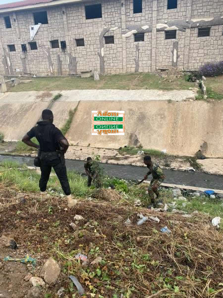 Security personnel hit Accra streets; desilt chocked gutters