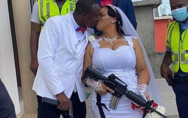 Bride carries gun to wedding ceremony - (Photo) 10