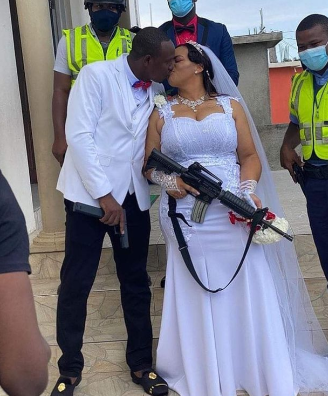 Bride carries gun to wedding ceremony - (Photo) 11