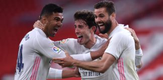 Nacho of Real Madrid celebrates with team mates (L - R) Casemiro and Alvaro Odriozola after scoring their side's first goal during the La Liga Santander match between Athletic Club and Real Madrid Image credit: Getty Images