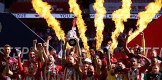 Pontus Jansson of Brentford lifts the Sky Bet Championship Play Off Trophy following victory in the Sky Bet Championship Play-off Final between Brentford FC and Swansea City at Wembley Stadium on May 29, 2021 in London, England. Image credit: Getty Images