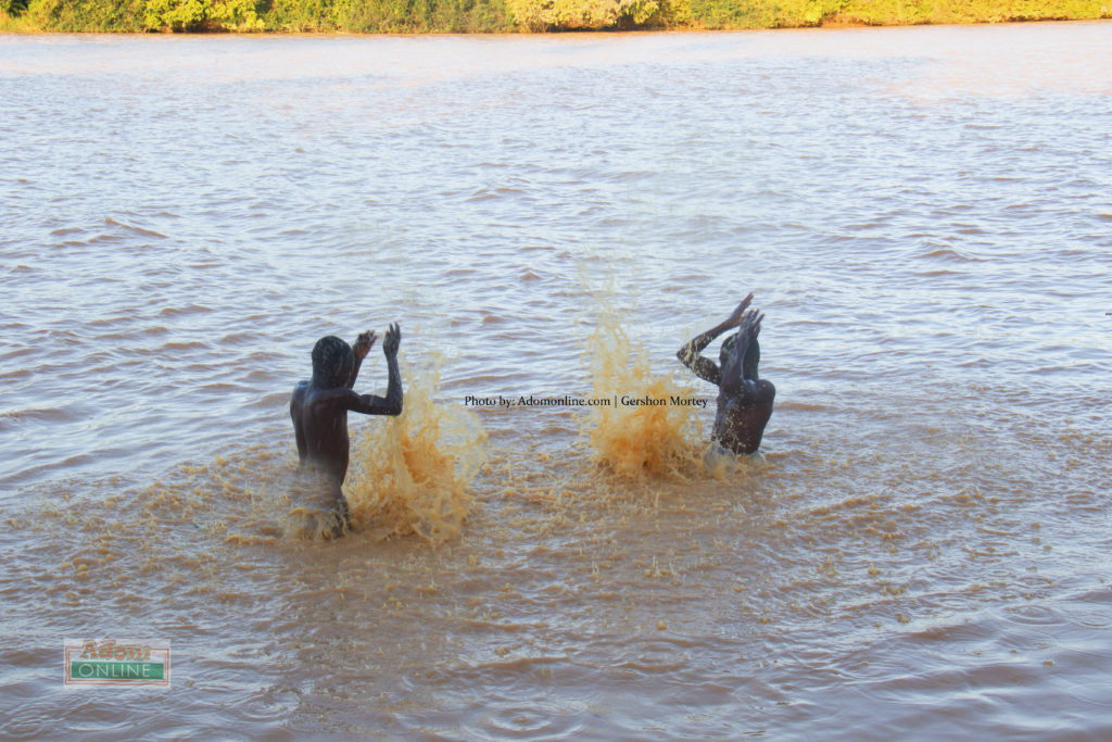 Two boys take a swim in River Pra at Borkokope in the Shaman District, Western Region | Adomonline.com