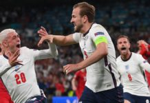 England's forward Harry Kane (R) celebrates with England's midfielder Phil Foden (L) after scoring a goal during the UEFA EURO 2020 semi-final football match between England and Denmark at Wembley Stadium in London on July 7, 2021. Image credit: Getty Images