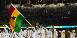 TOKYO, JAPAN - JULY 23: Flag bearers Nadia Eke and Sulemanu Tetteh of Team Ghana lead their team during the Opening Ceremony of the Tokyo 2020 Olympic Games at Olympic Stadium on July 23, 2021 in Tokyo, Japan. (Photo by Matthias Hangst/Getty Images)