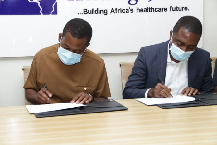 CEO of Africa Health Holdings Sangu Delle [in brown] and Dr Maxwell Antwi Country Director of PharmAccess [in blue]