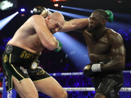 LAS VEGAS, NEVADA - FEBRUARY 22: Deontay Wilder punches Tyson Fury during their Heavyweight bout for Wilder's WBC and Fury's lineal heavyweight title on February 22, 2020 at MGM Grand Garden Arena in Las Vegas, Nevada. (Photo by Al Bello/Getty Images)
